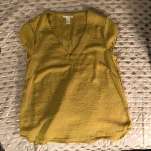 Yellow V neck silk like blouse.